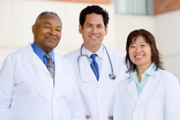 Photo of three doctors standing together