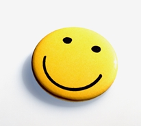 Yellow smiley face button